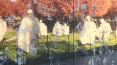 Close-up zoom of the Korean War Veterans Memorial wall in Washington DC Stock Footage