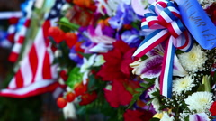 Close-up of flowers and flags with rack focus at the Korean War Veterans Stock Footage