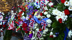 Static shot of flowers and flags at the Korean War Veterans Memorial in Stock Footage