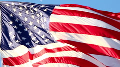Close-up shot of the American flag flying over the Korean War Veterans Memorial Stock Footage