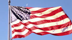 Close-up handheld shot of the American flag flying over the Korean War Veterans Stock Footage
