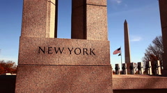 Slow panning shot of New York pillar at the World War II Memorial in Washington Stock Footage