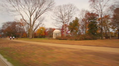 A panning shot of a memorial in a park during the fall in Washington DC. Stock Footage