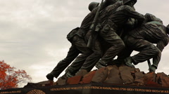 A panning up shot of the Marine Corps War Memorial on a breezy day during the Stock Footage