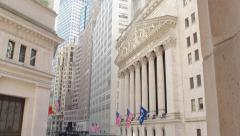 Wall Street stock exchange building tracking slider dolly Stock Footage