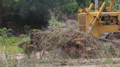 Unidentified worker control Bulldozer to excavator grader removing the ground - stock footage