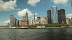 View of the Skyscrapers in New York while floating the East River. Stock Footage