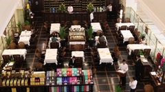 People sit at restaurant in Siam Paragon Mall. Bangkok, Thailand Stock Footage
