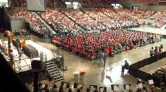 4K graduates standing and clapping for commencement speaker Stock Footage