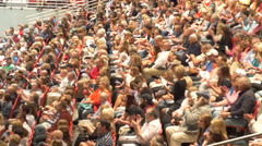 4K large crowd profile giving standing ovation. - stock footage