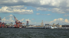 View of the Red  Hook Container Terminal while floating the East River. Stock Footage