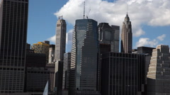 View of the New York City Skyline while floating the East River by ferry. Stock Footage