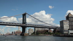 View of the Brooklyn and Manhattan Bridge while floating East River by Ferry. Stock Footage