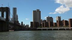 Panning view while floating the East River near the Brooklyn Bridge. Stock Footage