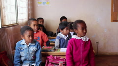 Static shot of young kids in a classroom. Stock Footage