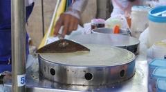 Man making local pancakes crape Stock Footage