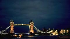 Tower Bridge, London, UK illuminated at night, time lapse Stock Footage