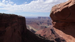 Dolly motion overlooking the Green River from Dead Horse Point near Moab Utah. Stock Footage