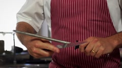 Cooking, sharpen knife Stock Footage