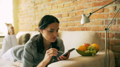 Woman reading bad news on cellphone Stock Footage