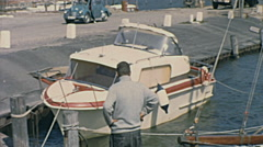 Sylt, West Germany 1967: small yacht docking in the port Stock Footage