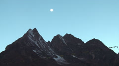 The moon in the morning sky above Himalayan peaks. Stock Footage