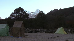 Tents in the Himalayas with Ama Dablam in the distance. Stock Footage