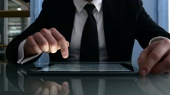 Man using digital tablet computer night in the office Stock Footage