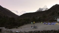 Climbers getting ready at sunrise near Everest. Stock Footage