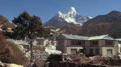 Buildings with flags and trees near Ama Dablam. Stock Footage
