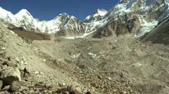 Panorama of a glacier flowing down a valley from the Himalayas. Stock Footage