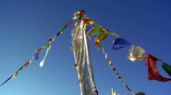 Buddhist prayer flags on a pole waving in the breeze. Stock Footage