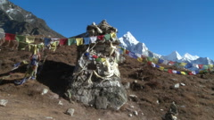 Monument with Buddhist prayer flags in the Himalayas. Stock Footage