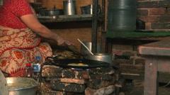 Nepali woman cooking Nepali food. Stock Footage