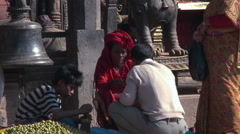 Man bartering in village marketplace in Nepal. - stock footage