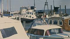 Sylt, West Germany 1967: yachts docking in the port Stock Footage