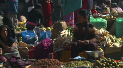 Stock Video Footage of Vendors at a Nepali marketplace.