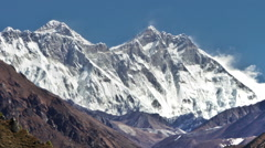 Panning shot of Time-lapse of Everest and surrounding peaks and people on a Stock Footage