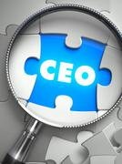 CEO - Puzzle with Missing Piece through Loupe Stock Illustration