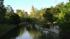 Static view of the San Antonio River looking towards the Tower of Life Building. Stock Footage