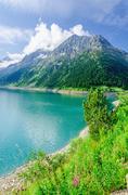 Azure mountain lake and high Alpine peaks, Austria Stock Photos