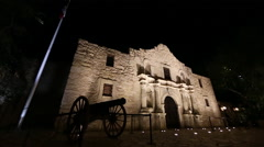 Slow downward panning view of the Alamo at night. - stock footage