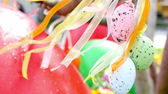 Easter decoration with colorful eggs hanging on a tree Stock Footage
