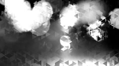 Graphic black and white animation with triangles and flashes of light in bokeh Stock Footage