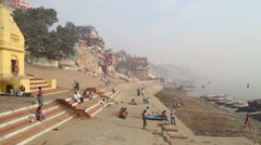 People at ghat in Varanasi, with view on Ganges river. Stock Footage