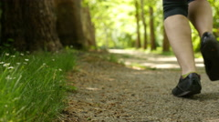 A woman jogging / running in park - stock footage