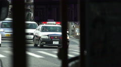 Covert Handheld Shot Of Japanese Police Car - stock footage