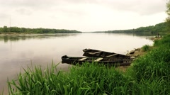 Traditional fishing boats moored on Vistula riverbank near Warsaw, Poland Stock Footage