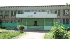 Old Elementary school building establishing shot Stock Footage