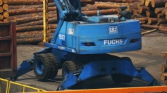Close up of rotating tower of loading machine while unloading cargo train at car Stock Footage